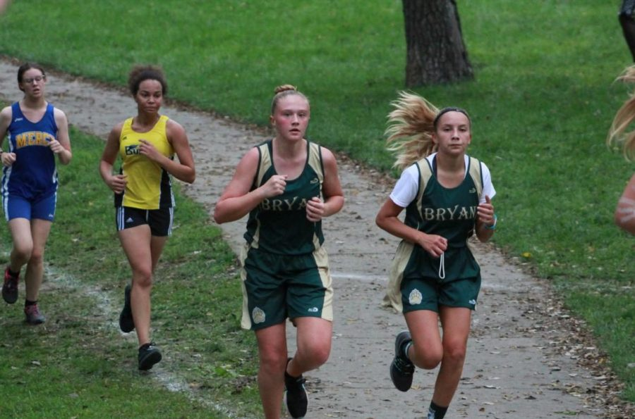In the last half of the race, freshmen Ruby Nelson and Isabel Stewart come around a curve together at the Sept. 8, Omaha Central Invitational at Walnut Grove Park.  Stewart went on to finish the JV race 17th with a time of 25:33.40. Nelson finished 28th with a time of 26:22.60.