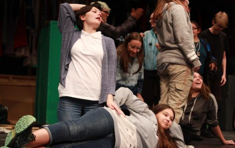"Sophomore Lily Huse gasps dramatically as the rest of the ""Me, My Selfie, and I"" cast lies around her, pretending to be mermaids during a warm up activity prior to rehearsal."