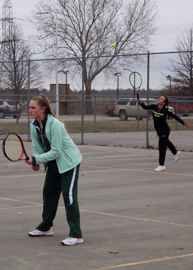 Serving+the+ball+to+her+opponent%2C+sophomore+Sophia+Rubenstein+starts+the+new+point+while+junior+Olivia+Rickley+waits+for+the+return.+Being+the+last+team+to+play+a+doubles+match+against+Omaha+South+High%2C+Rubenstein+and+Rickley+were+the+only+thing+standing+between+a+loss+or+win.+After+a+rough+start%2C+the+girls+pulled+through+and+won+8-2%2C+making+the+teams+overall+score+5-4.+