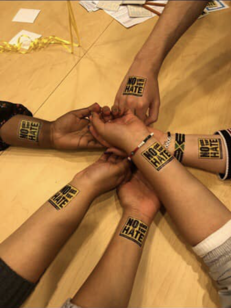 Representing Bryan High, Mohamud alongside other Bearclusity members show off the fake tattoos they got at a No Place for Hate Rally. At the rally they also talked about how they have used this program this year. This is only one of the places the Mohamud volunteers at.