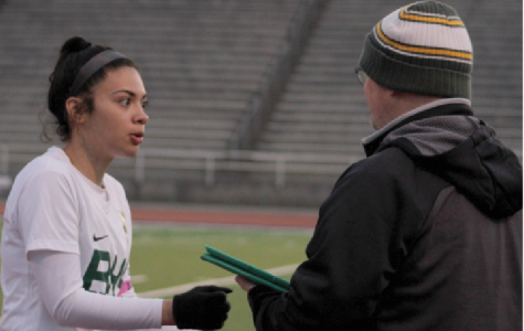 "At the April 4, varsity girls soccer game against Marian, 2019 alumna  Angela Miranda gets advice from then, assistant coach Thomas Townsend. Miranda, who now plays for Bellevue University, played for Townsend for three years. ""He encouraged me to continue playing because I was unsure and he believed that I was capable of playing at the next level which meant a lot,"" Miranda said. ""He was always there for anything including on and off the field. He knows the sport so well. It was an honor for me to get coached by him."""