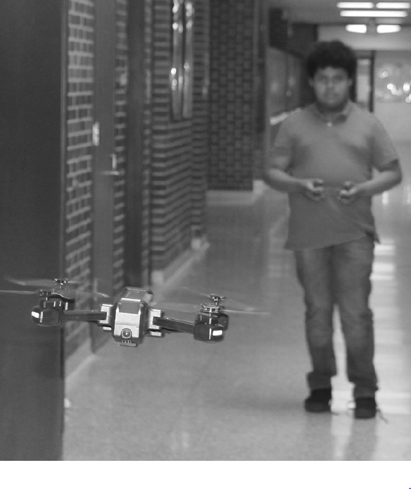 As part of the school's robotics club, freshman Kevin Ruiz-Gallardo flies a Mavic HS107 drone through the west hallway after school. Ruiz-Gallardo will participate in the CREATE Whirl Wind Drone Competition which will be hosted at the school on Dec. 21.