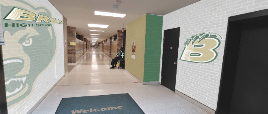 After taking a photo of the hallway all students pass through as they enter the building each day, social studies teacher and Branding Committee member Nicholas Wennstedt makes a mock up of an idea of what the entrance could possibly look like in the near future utilizing the school's new logos and official colors. Principal Dr. Rony Ortega plans to meet with two companies before winter break to get estimates of this potential project and others throughout the school.