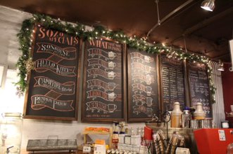 Bringing her own chalk to create the menu with visuals and fonts Manager, Alyssa Bussu has been updating the Sozo's Coffeehouse menu for five years.