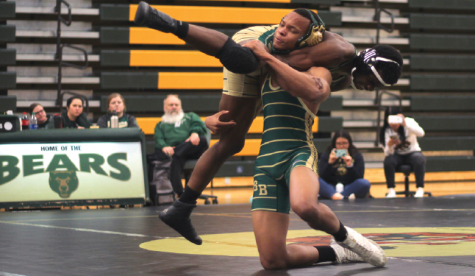At the Green and Gold scrimmage on Dec. 3, junior Steven Sturdivant does a double on sophomore Yusuf Mohammed and receives 2 points. Ultimately the match finishes with Mohammed winning 6-3.