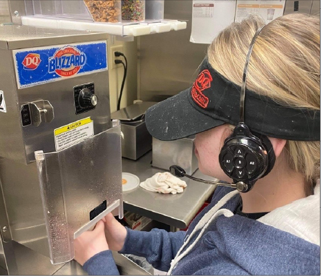 Making a blizzard at her work on Oct. 25, sophomore Natalie Besta starts her shift at the Dairy Queen on 72nd and Q.