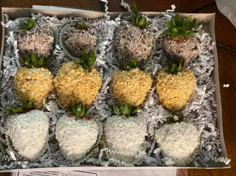 Assorted strawberries covered in cookies and cream chunks, peanuts and coconut shavings. They are $35 for the set.
