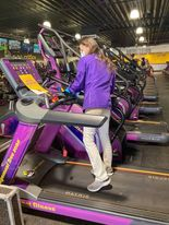 "At the Planet Fitness located on 5035 S. 36th Street, assistant manager Ally Smith sanitizes one of the treadmills. ""Our brand is heavily focused on cleaning anyway,"" Smith said. ""With the pandemic we've just double downed on that. Insuring our member's safety is top priority."""